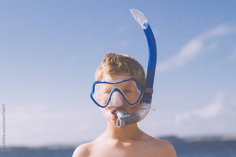 Young boy ready for diving with snorkel by Jonas Räfling for Stocksy United