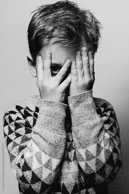 Boy Peeking Through His Fingers by Cameron Whitman for Stocksy United