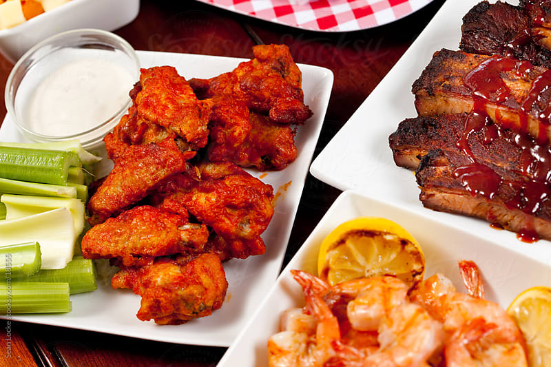 Tailgate Food: Focus on Chicken Wings by Sean Locke for Stocksy United