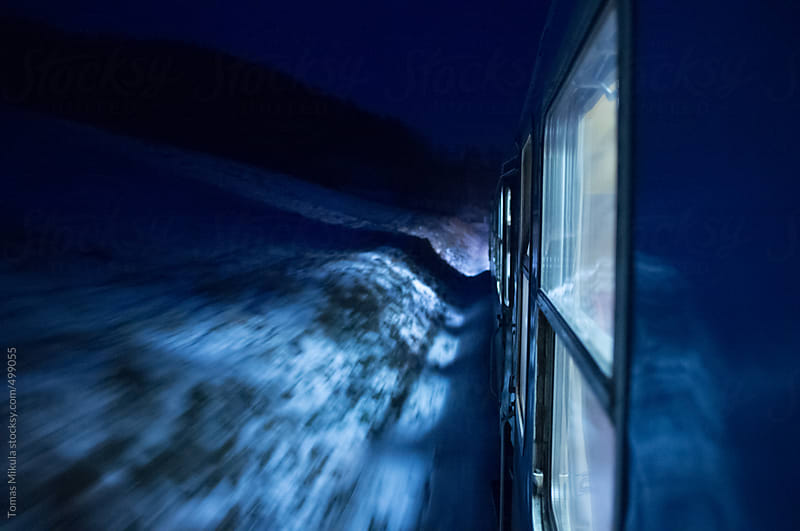 Traveling by train in winter night by Tomas Mikula for Stocksy United
