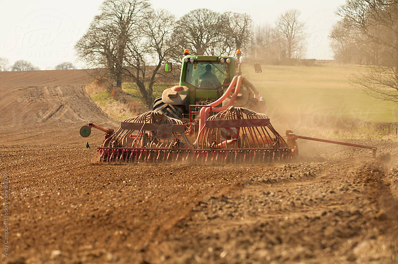 A tractor sowing a field by Andy Campbell for Stocksy United