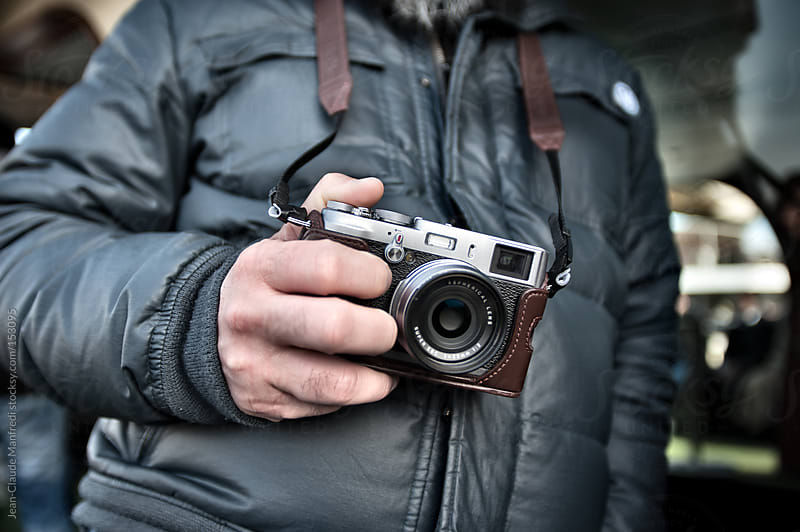 Man holds his vintage camera by Jean-Claude Manfredi for Stocksy United