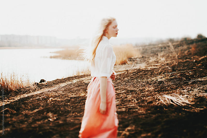 Young Blonde girl walks on the field by Sergey Filimonov for Stocksy United