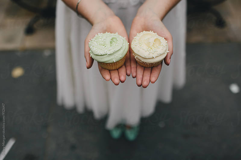 Bride Holding Cupcakes by Sidney Morgan for Stocksy United