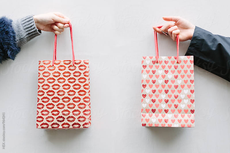 Friends Holding Shopping Bags against a White Background by HEX. for Stocksy United