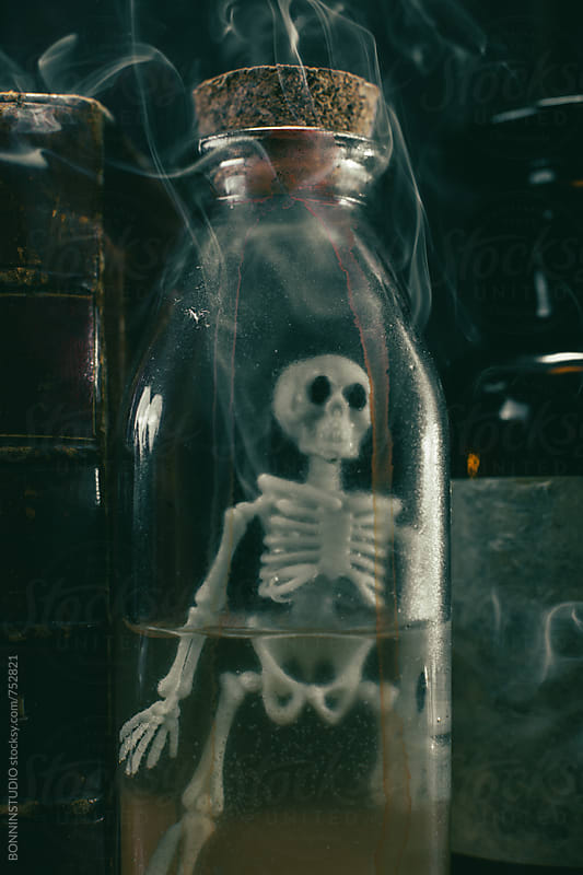 Halloween decor. Skeleton in a witch's potion. by BONNINSTUDIO for Stocksy United