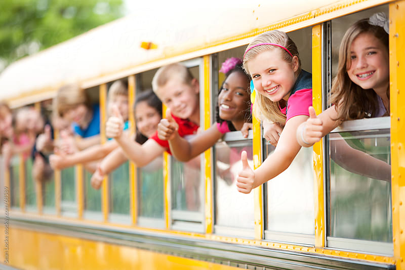 School Bus: Kids All Give Thumbs Up by Sean Locke for Stocksy United