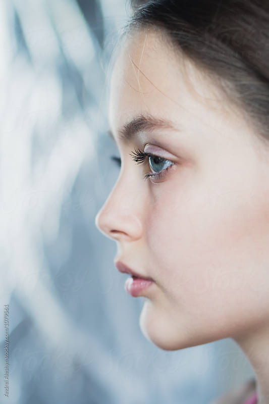 Profile of a beautiful young girl by Andrei Aleshyn for Stocksy United