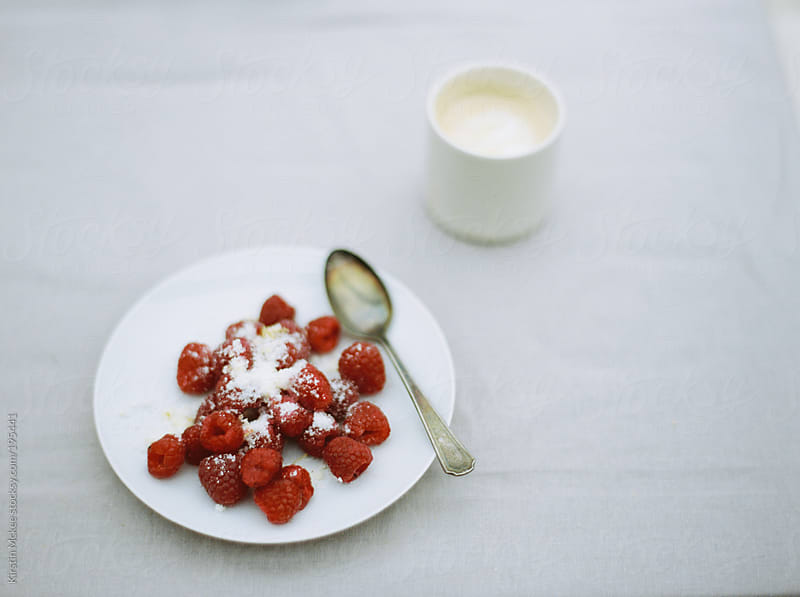 plate of raspberries with ricotta and a cup of coffee by Kirstin Mckee for Stocksy United