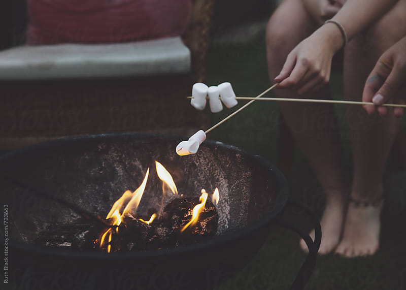 Toasting marshmallows by Ruth Black for Stocksy United
