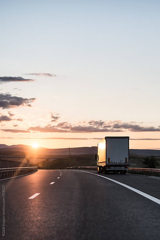 truck on the highway  by RG&B Images for Stocksy United