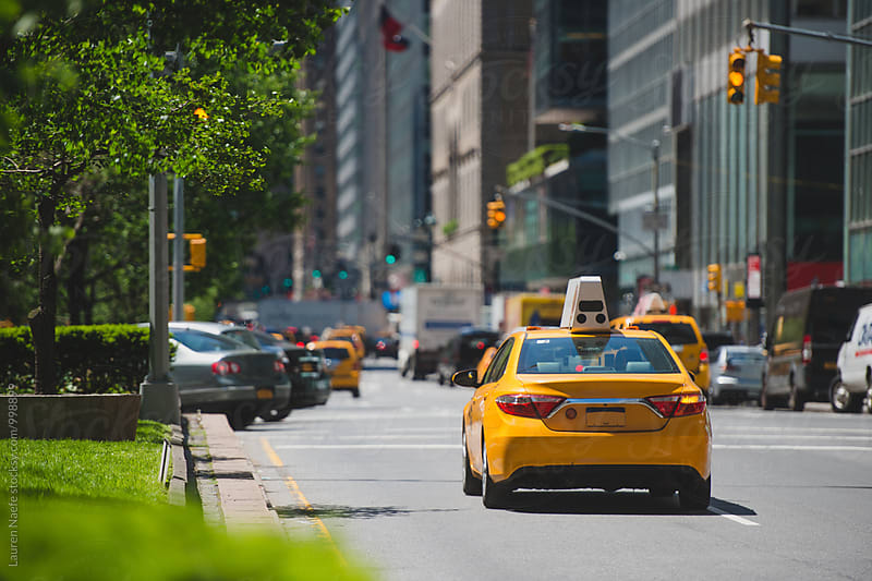 Yellow taxi moving through Park Avenue (Manhattan) by Lauren Naefe for Stocksy United
