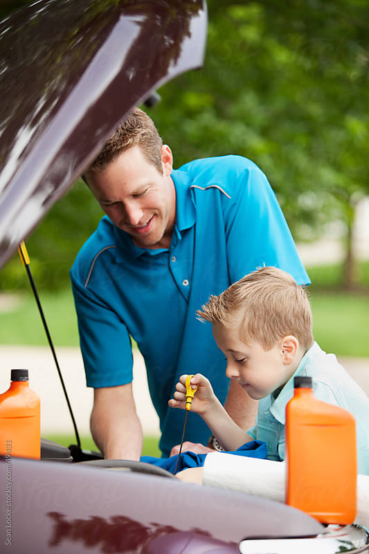 Father: Boy Checking Engine Oil Level by Sean Locke for Stocksy United