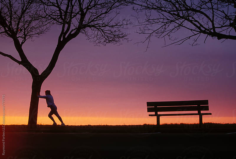 Woman Stretching before Run at Dawn by Raymond Forbes LLC for Stocksy United