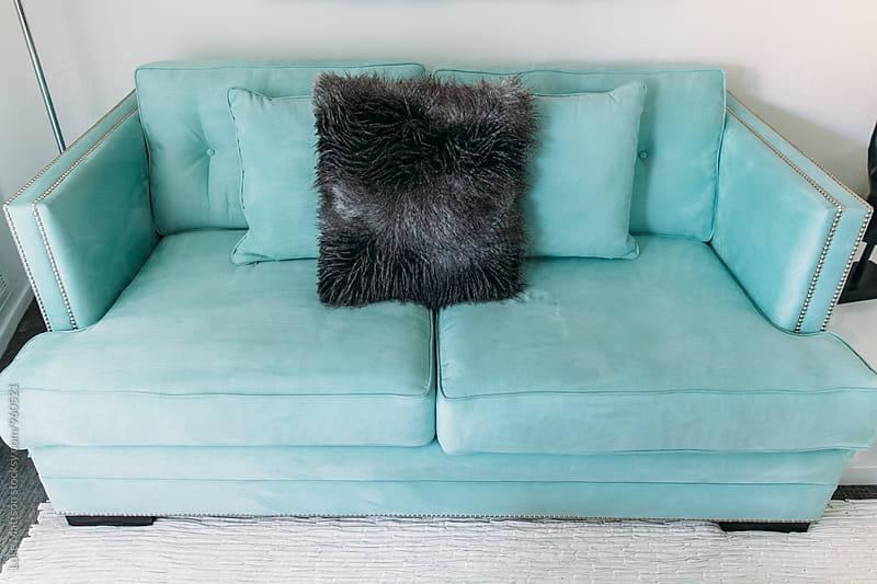 Light Blue Couch In Resort Hotel Room by Luke Mattson for Stocksy United
