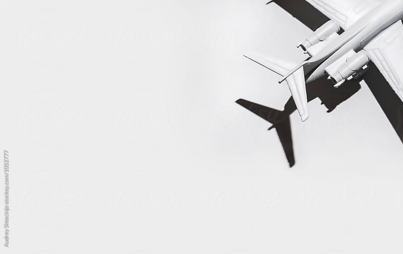 White airplane on white background/miniature by Marko Milanovic for Stocksy United