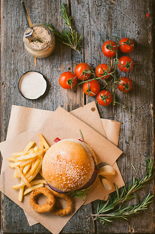 Beef burger with fries by Branislav Jovanović for Stocksy United