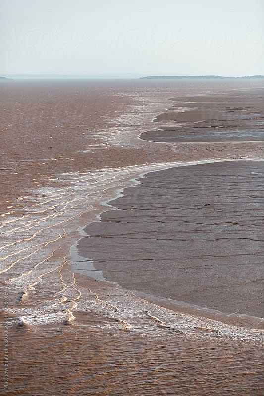 Sediment in moving water on Bay of Fundy during tide change by Matthew Spaulding for Stocksy United