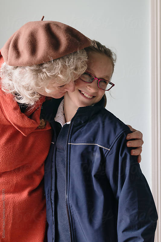 grandmother and granddaughter sharing a hug by Gillian Vann for Stocksy United