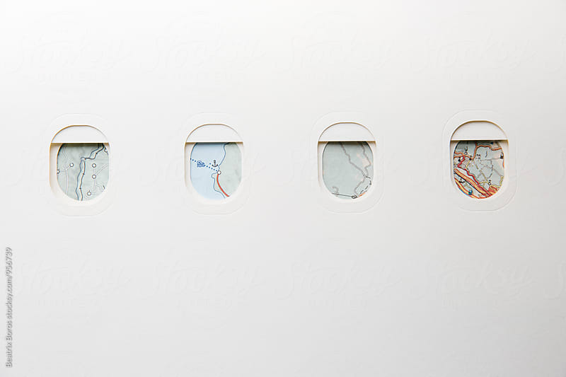 Conceptual travel photo of airplane windows with map view by Beatrix Boros for Stocksy United