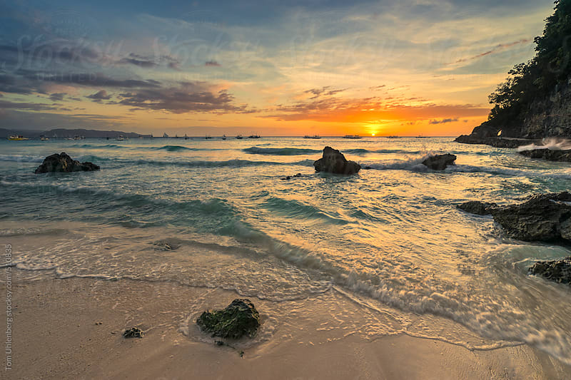Sunset on Boracay Island, the Philippines by Tom Uhlenberg for Stocksy United