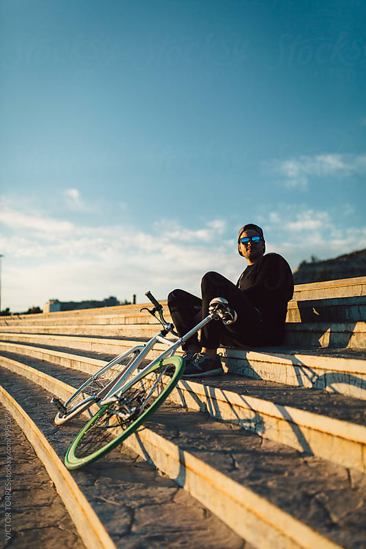 Youn Man with His Bicycle in a Radiant Summer Day