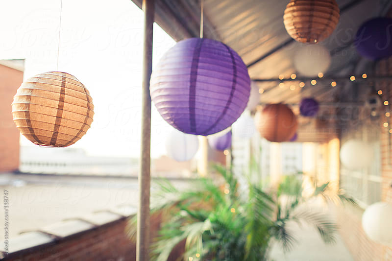 Colorful paper lanterns hanging outside by Jakob for Stocksy United