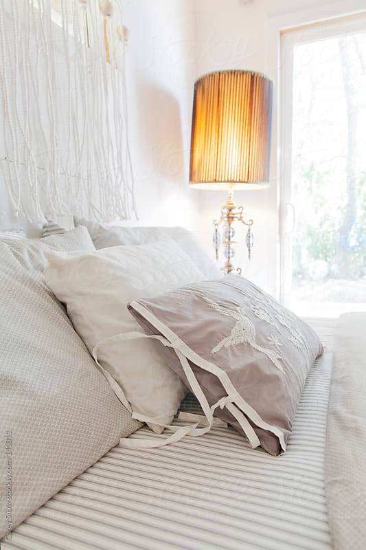 Detail of bed and lamp by Carey Shaw for Stocksy United