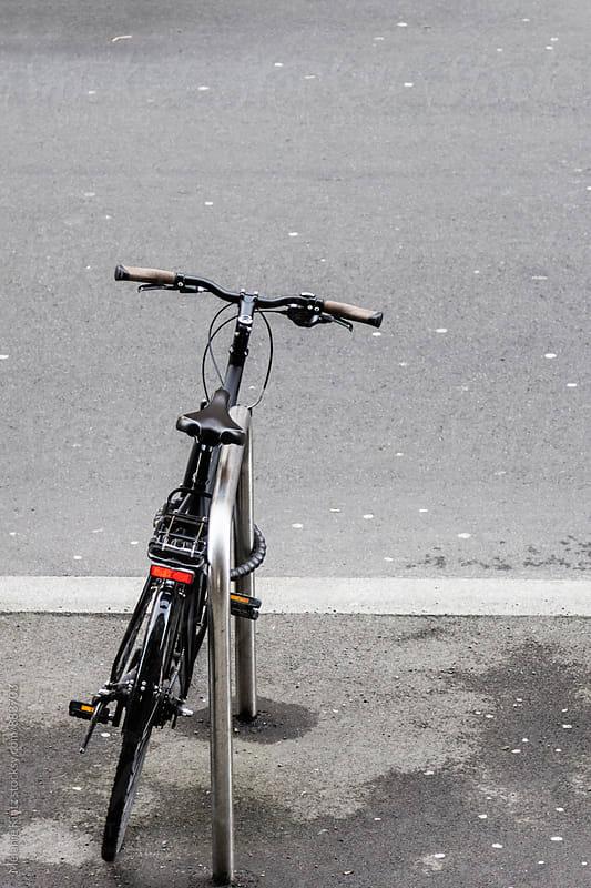 Lone bicycle parked on a sidewalk by Melanie Kintz for Stocksy United