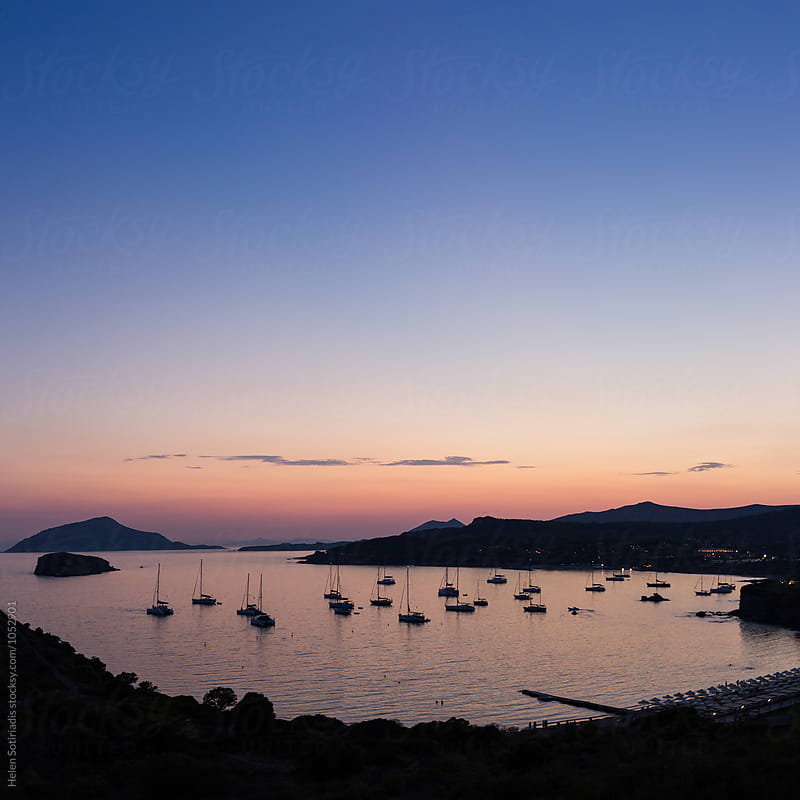 Sailboats Resting in a Bay at Sunset by Helen Sotiriadis for Stocksy United