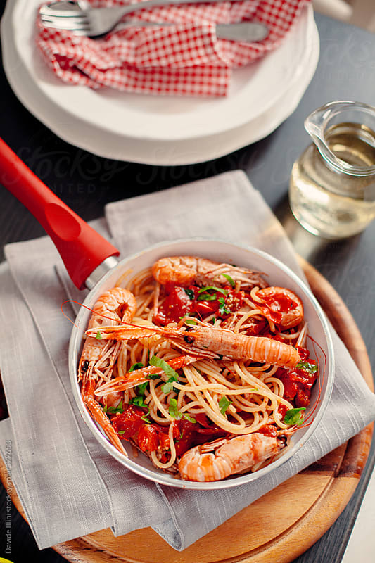 Spaghetti with cherry tomatoes and shrimp by Davide Illini for Stocksy United