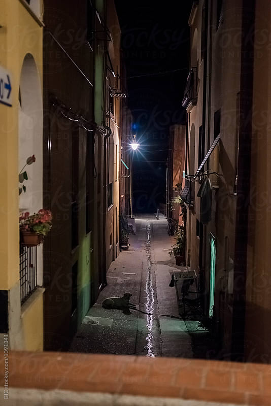 Italian town alley at night by Simone Becchetti for Stocksy United