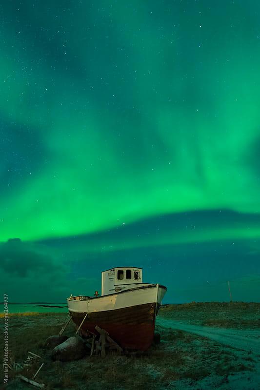 The Boat & The Aurora by Marilar Irastorza for Stocksy United