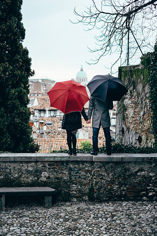 Young Couple Hand In Hand During Raining Day by HEX. for Stocksy United