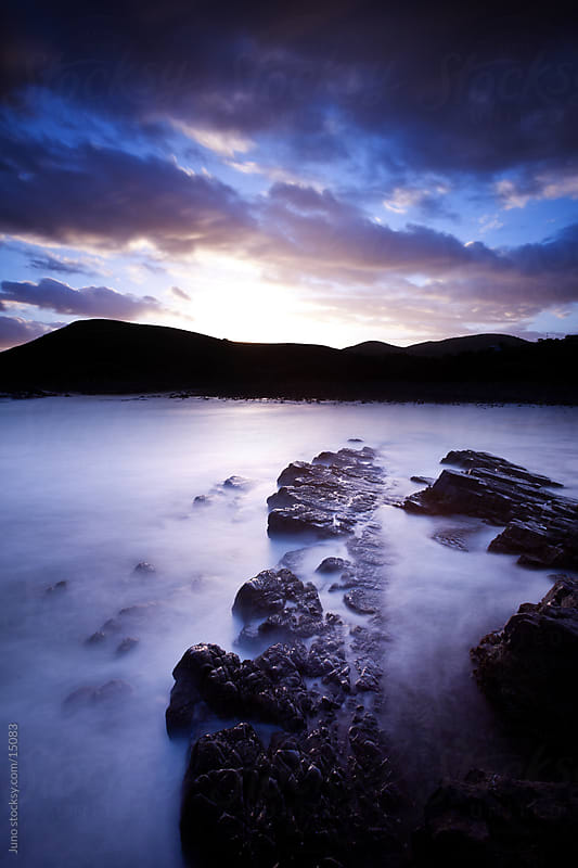 Long exposure rocky coast by Micky Wiswedel for Stocksy United