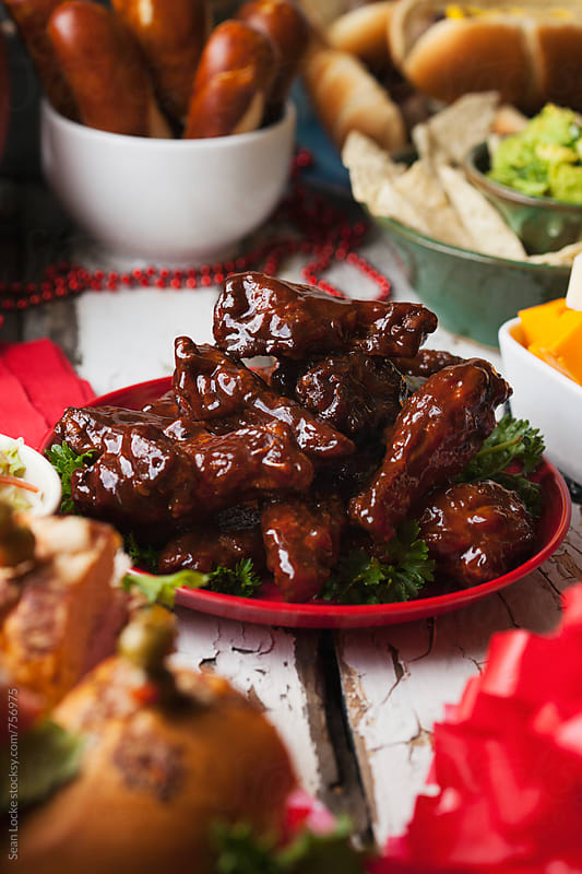Football: Plate Of Smoked And Sauced Chicken Wings by Sean Locke for Stocksy United