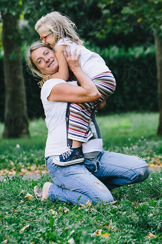 A little girl hugging her pregnant mom by michela ravasio for Stocksy United