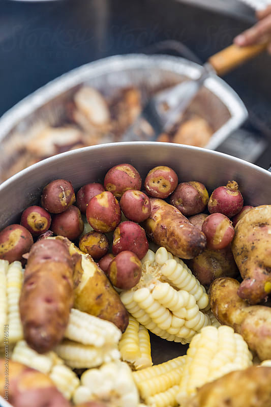 Large pot of cooked potatoes and peruvian corn by Ben Ryan for Stocksy United