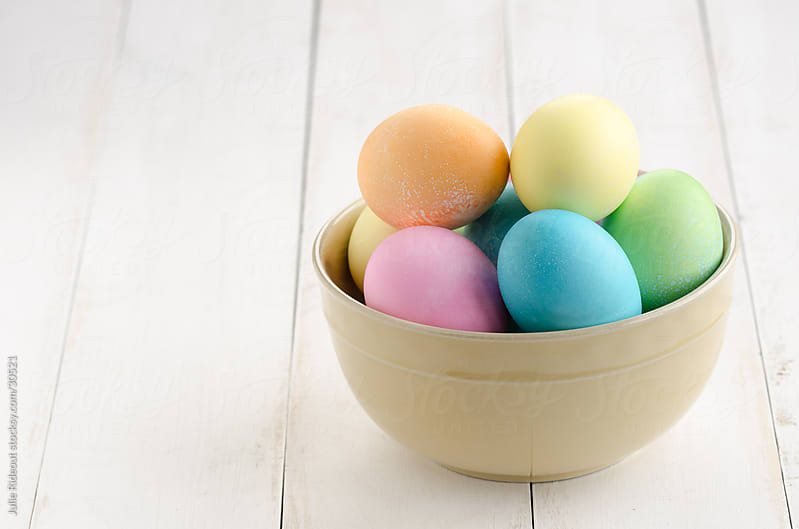 Homemade Easter Eggs in a Bowl by Julie Rideout for Stocksy United