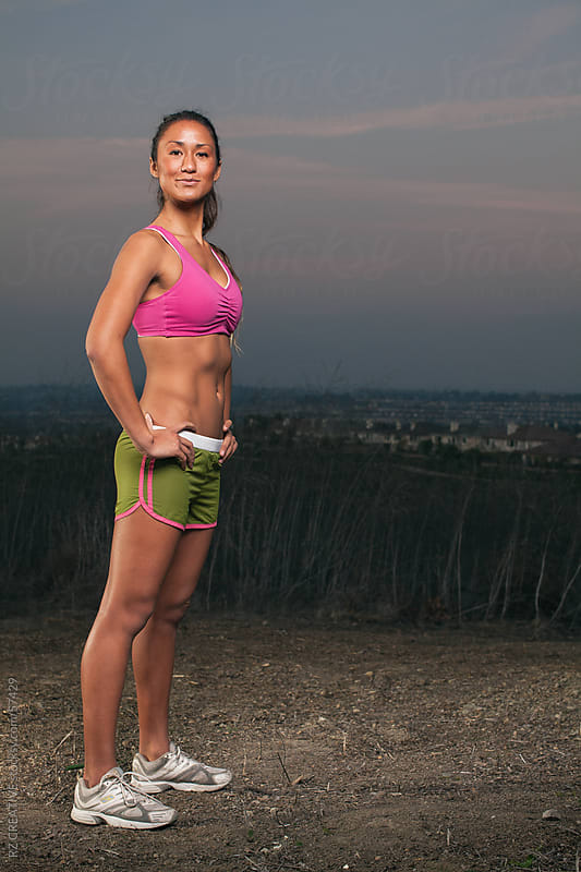 Full body picture of an athletic woman. by Robert Zaleski for Stocksy United