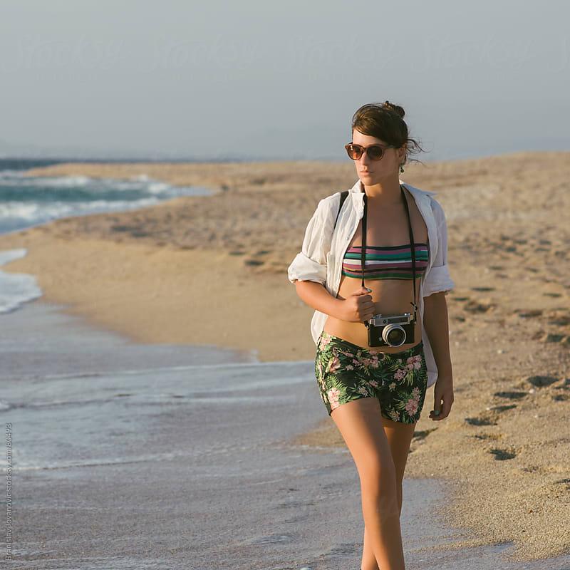 Girl With a Camera on the Beach by Branislav Jovanović for Stocksy United
