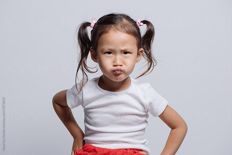 Studio shot of young Asian girl