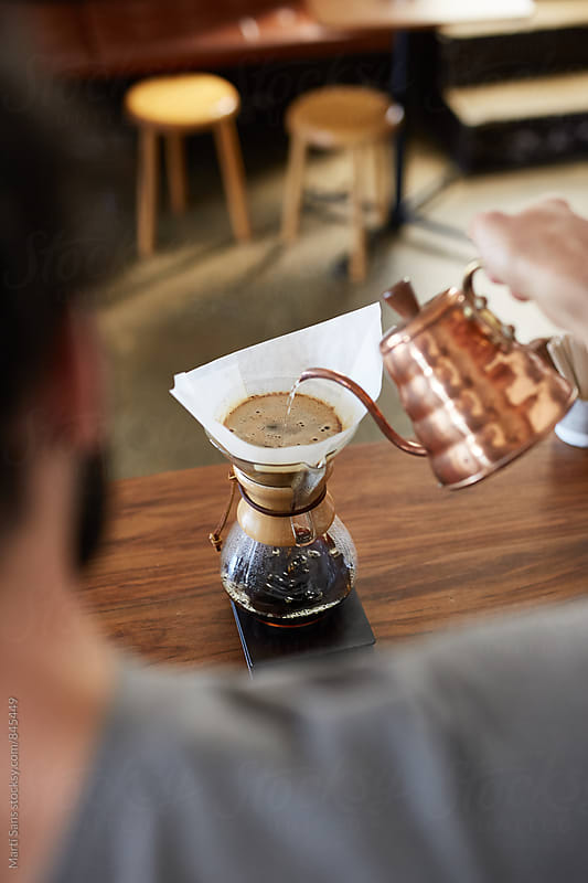 Barista pouring hot water in chemex by Martí Sans for Stocksy United