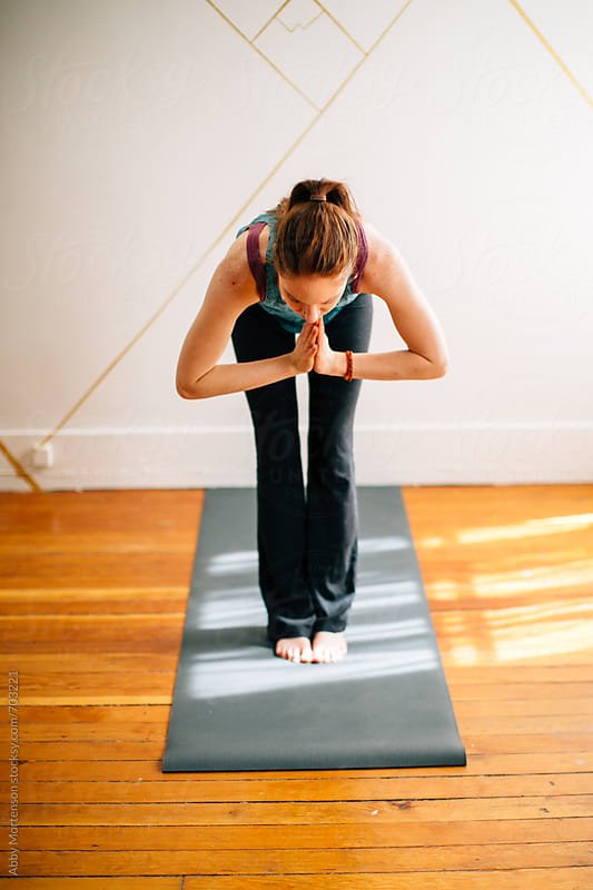 Woman Practicing Yoga in Studio by Abby Mortenson for Stocksy United