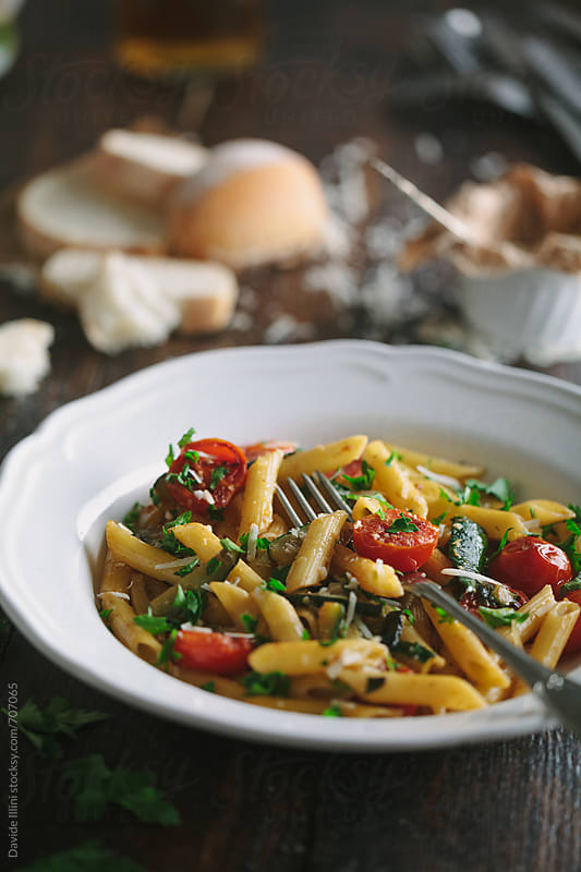 Italian pasta with fresh cherry tomatoes by Davide Illini for Stocksy United