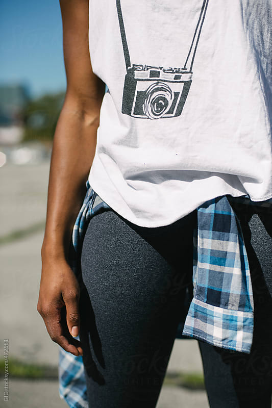 Casual female outfit with old camera on the t-shirt by GIC for Stocksy United