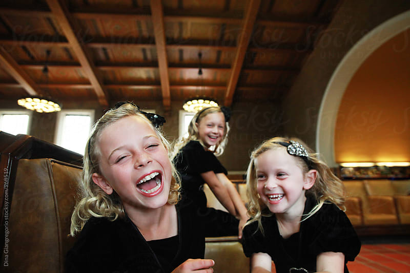 Three Blonde Sisters Laughing In Fancy House by Dina Giangregorio for Stocksy United