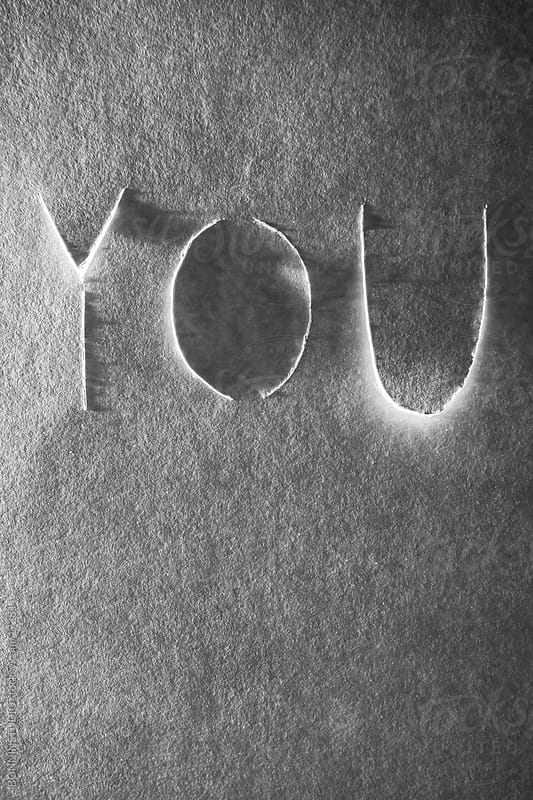 You word cropped on cardboard.  by BONNINSTUDIO for Stocksy United