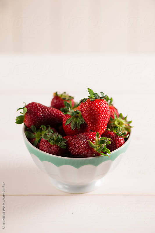 a bowl of strawberries by Laura Adani for Stocksy United
