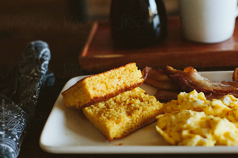 Cornbread served with breakfast by Christian Gideon for Stocksy United